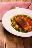 Spanish hot vegetable stew with duck breast Stock Image