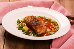 Spanish hot vegetable stew with duck breast Stock Photo