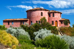 Spanish House. On Hill with shrubs Royalty Free Stock Image