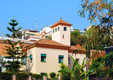 Spanish house. On a hill with garden royalty free stock image