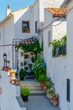 Spanish house with flower pots stock photography