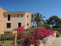 Spanish house with flowers in front. Near Cala Serena, Cala d'Or, Mallorca, Spain Stock Photo