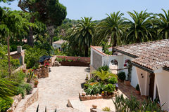 Spanish house with palm trees Royalty Free Stock Photo