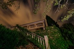 The spanish house under cloudy night sky. Long exposure royalty free stock photo