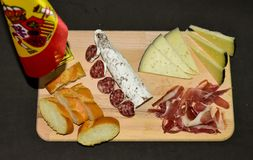 Spanish Iberian assortment, cheese, ham , sausage and bread royalty free stock images