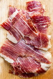 Spanish iberico ham slices closeup Stock Photos