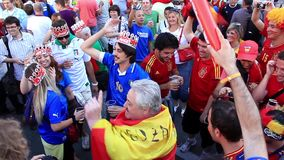 Spanish and Italian football fans before final match of EURO 2012 stock video footage