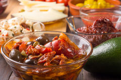 Spanish or italian starters with olives and peppers Stock Photo