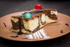 Free Spanish Italian Sweet Cake Desert On Clay Plate  And Antique Table Royalty Free Stock Photos - 185570408