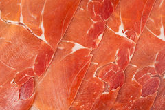 Spanish jamon iberico sliced. As a background Royalty Free Stock Photos