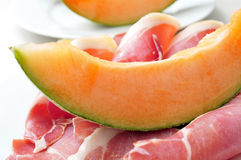 Spanish jamon serrano and melon Stock Photos
