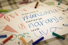 Spanish; Kids Writing Name Of The Fruits For Practice Royalty Free Stock Images