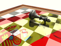 Spanish king's abdication. King piece of a chess game, lying on the chessboard where is reflected a spanish flag. Abstract presentation of the abdication of stock illustration