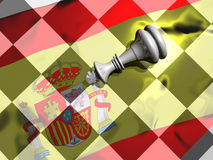 Spanish king's abdication. King piece of a chess game, lying on the chessboard where is reflected a spanish flag. Abstract presentation of the abdication of Royalty Free Stock Photos