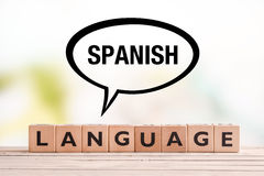 Spanish language lesson sign on a table. Spanish language lesson sign made of cubes on a table Stock Image