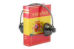 Spanish language textbook with headset, learning and translate c. Oncept Stock Photos
