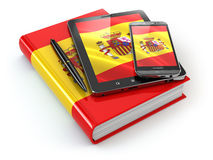 Spanish learning. Mobile devices, smartphone, tablet pc and book Stock Images