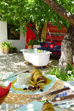 Outdoor Spanish lunch in a quirky setting. A Spanish meal in a bright, colourful and quirky setting, under the shade of a tree Royalty Free Stock Photo