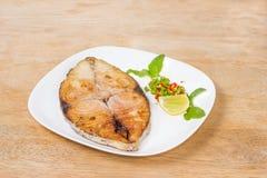 Spanish mackerel steak on wood background,fried fish Stock Photography