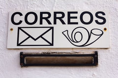 Spanish Mailbox. The sign on the white wall. Royalty Free Stock Image