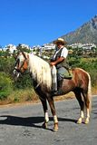 Spanish man on horse, Marbella. Royalty Free Stock Images