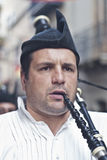 Spanish man playing bagpipes Stock Images