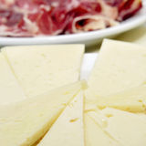 Spanish manchego cheese and serrano ham. Some plates with manchego cheese and serrano ham served as tapas Stock Images