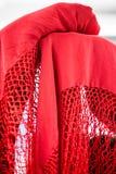 Spanish Manton shawl. Close up of red Spanish Flamenco Manton shawl on back of chair Royalty Free Stock Photo
