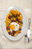 Spanish meal with sliced chorizo, roasted potato and fried egg Stock Images