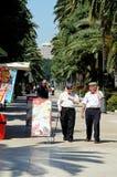 Spanish men along promenade, Malaga. Stock Photos