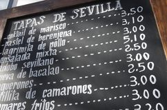 Spanish menu. Foreground of a  poster of the menu in a typical Spanish restaurant, Sevilla, Andalusia, Spain Stock Photos