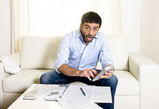 Spanish mexican business man worried paying bills on couch Royalty Free Stock Photos