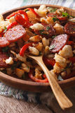 Spanish migas close-up on a plate. vertical Stock Image