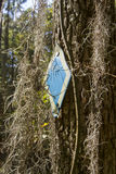Spanish moss and trail marker Royalty Free Stock Images