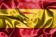 Spanish National Flag Waving In The Wind With Map Of Spain On It Royalty Free Stock Photography