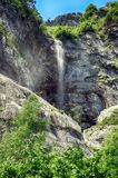 Alpine rill and mountaine forest in the National Park of Ordesa. Spanish National Park of Ordesa in the Pyrenees in a zone of rills and runlets between cliffs Stock Images