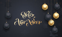 Spanish New Year Feliz Ano Nuevo decoration golden ornament greeting. Spanish Happy New Year Feliz Ano Nuevo golden decoration ornament with Christmas ball on Royalty Free Stock Image
