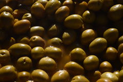Spanish olives. Olives without preservatives. Olives in a brine. Delicacies. What is eaten in Spain stock image