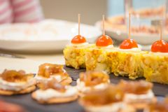 Spanish omelet tapas and cheese with onion pinchos Royalty Free Stock Image