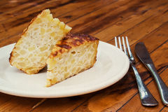 Spanish omelet on a white plate. Stock Photo