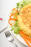 Spanish omelette 01. Omelette in a plate with fork and vegs Stock Photo