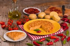 Spanish omelette. Spanish omelette with chorizo and chilli peppers stock photo