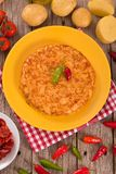 Spanish omelette. Spanish omelette with chorizo on wooden table stock image