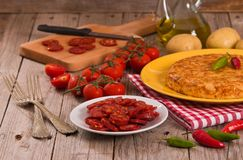 Spanish omelette. Spanish omelette with chorizo on wooden table royalty free stock photo