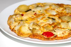 Spanish omelette meal with potato, onion, chicken, peppers and a Stock Image