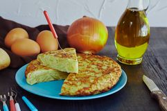 Spanish omelette with potato, egg and onion, accompanied by olive oil royalty free stock photography