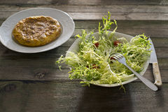 Spanish omelette and salad Royalty Free Stock Image