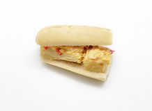 Spanish omelette sandwich with olive oil and red pepper isolated Stock Photography