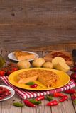 Spanish omelette. Spanish omelette with chorizo and chilli peppers royalty free stock images