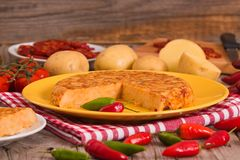 Spanish omelette. Spanish omelette with chorizo and chilli peppers stock photography